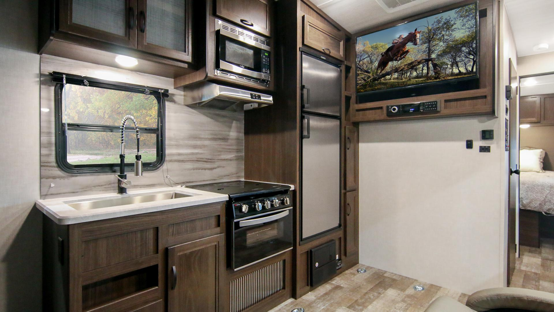 Winnebago Spyder galley full view, including entertainement area