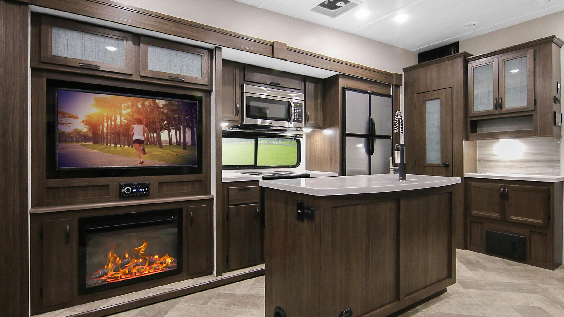 Voyage Fifth Wheel V3134RL Featuring Island, 12. cu. ft. Refrigerator, Pantry, Microwave, Entertainment Center