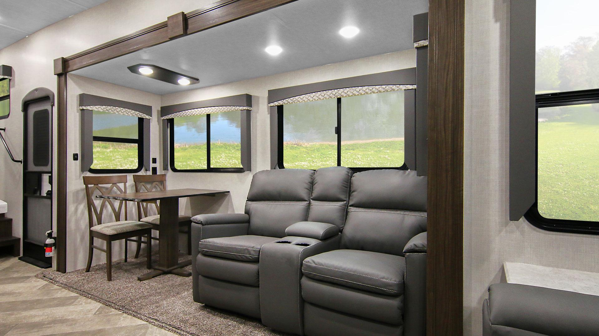 Voyage Fifth Wheel V3134RL Slideout Featuring Theater Seating and Dining Table and Two Chairs