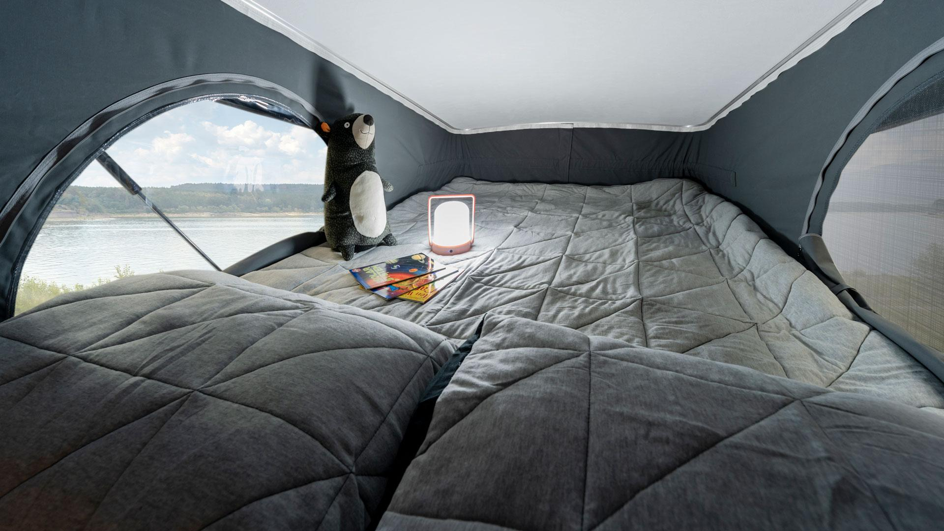 Winnebago Solis pop-top bed, screen windows open detail view