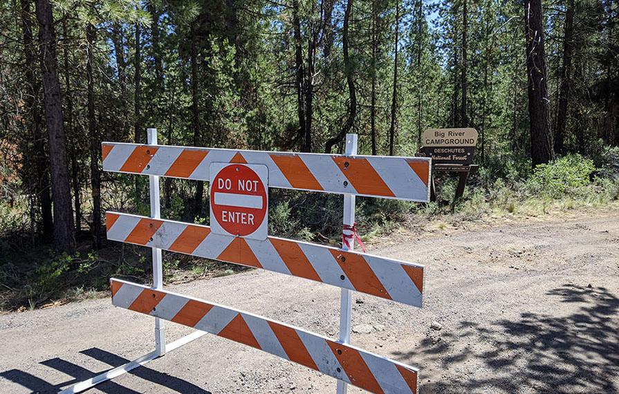 Barricaded road of closed campground