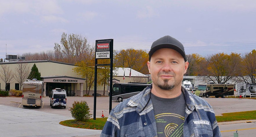 Kenny standing in front of Factory Service Center