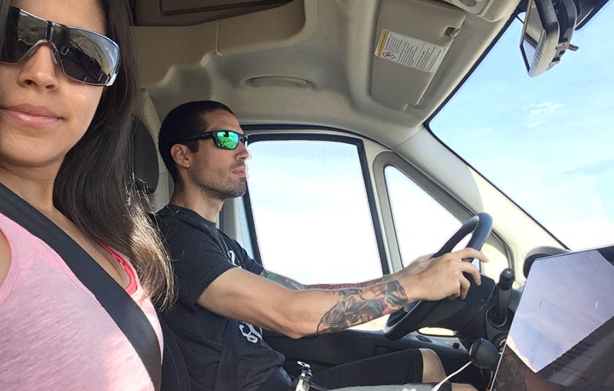 Nadia taking selfie with Jon while Jon drives the Trend