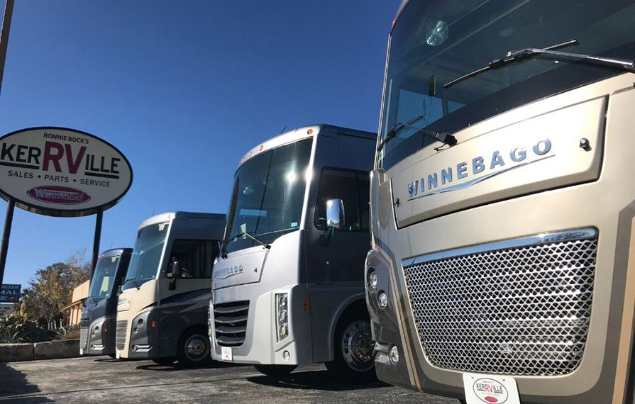 Winnebago Class A motorhomes lines up at dealership
