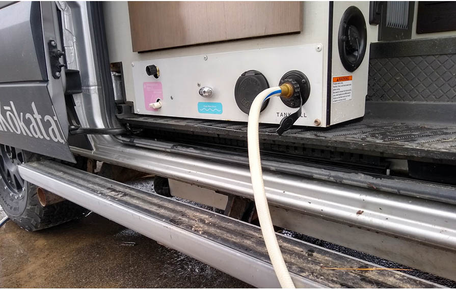 Hose attached to water hook-up on Motorhome.