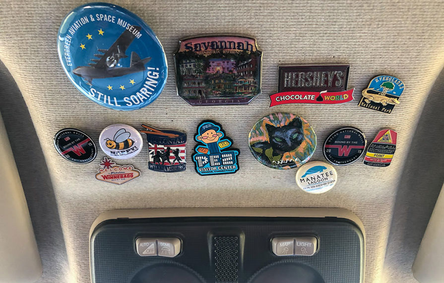 Collection of pins and patches in cab of Travato