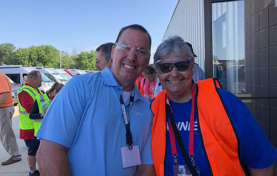 Sue Ann and Winnebago Employee smiling for a photo wearing safety glasses