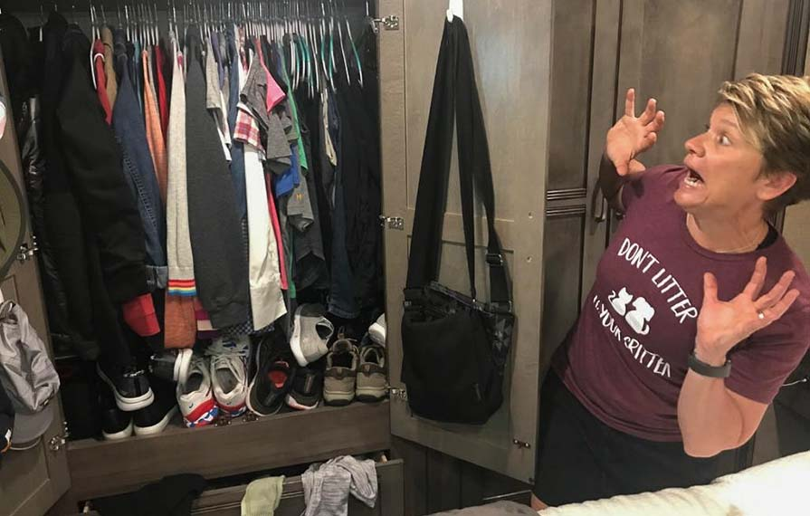 Lin looking terrified at a closet full of unorganized clothes