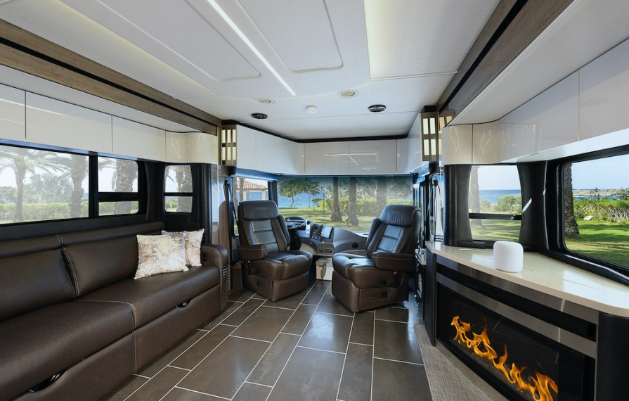 Interior shot of the Horizon showing from middle to front of the coach. Fireplace is on.