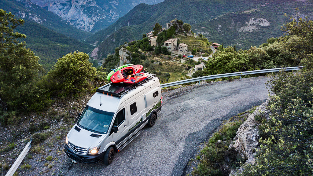 Winnebago Revel being driven in Spain with a valley and town below