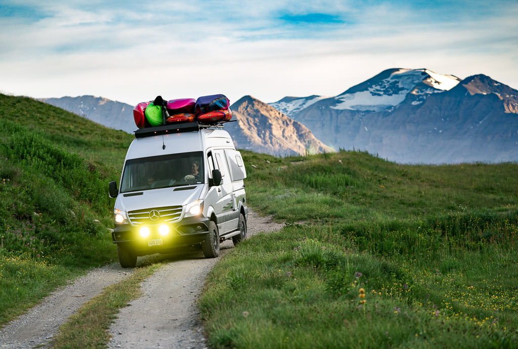 Winnebago Revel being driven on dirt road through the Swiss Alps