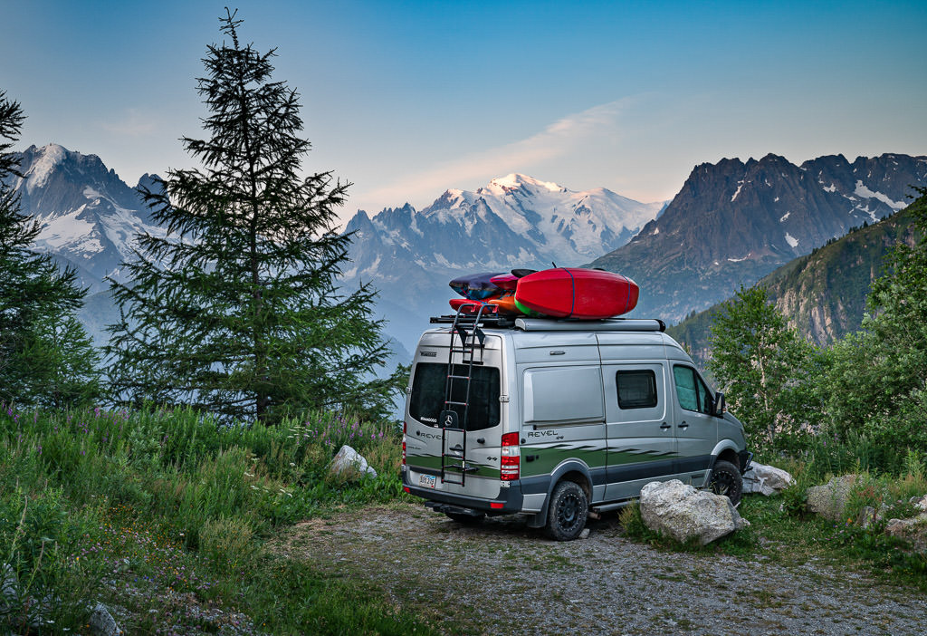 Winnebago Revel parked with the Swiss Alps in the background.