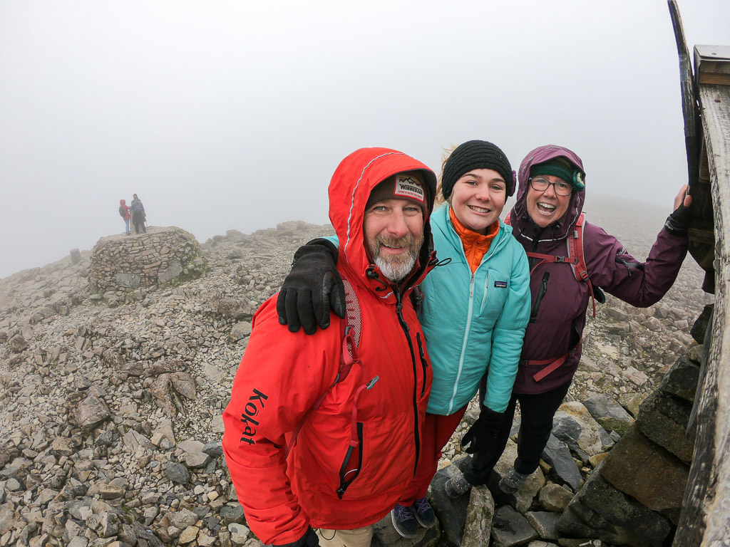 Holcombe family in sea of clouds at top of the mountains
