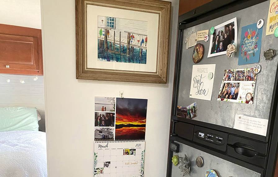 Display of photos on wall and on fridge