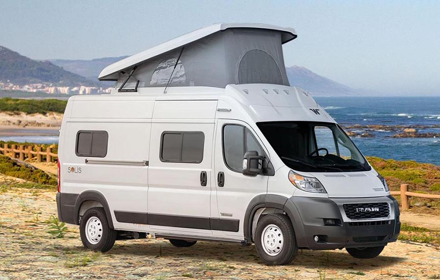 Winnebago Solis with pop-top up on the beach.