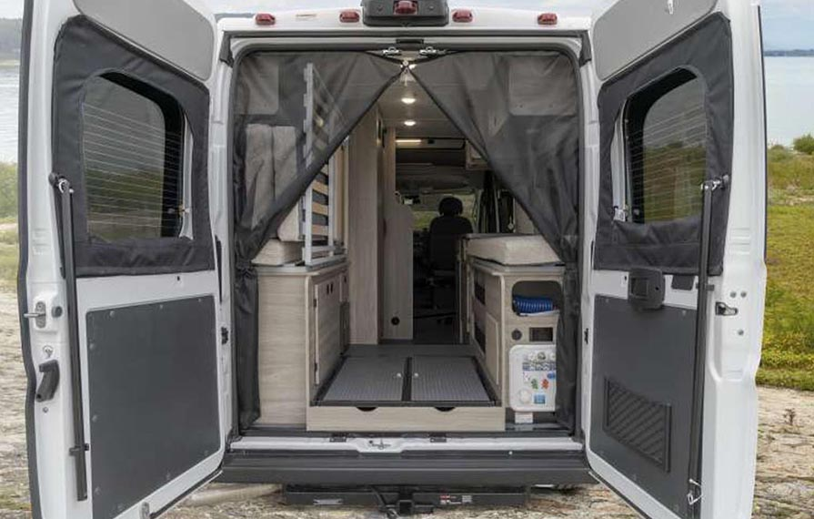 Back doors of Winnebago Solis open to show a view of the inside.