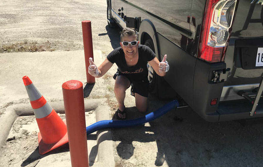 Noel giving two thumbs up after dumping RV for first time