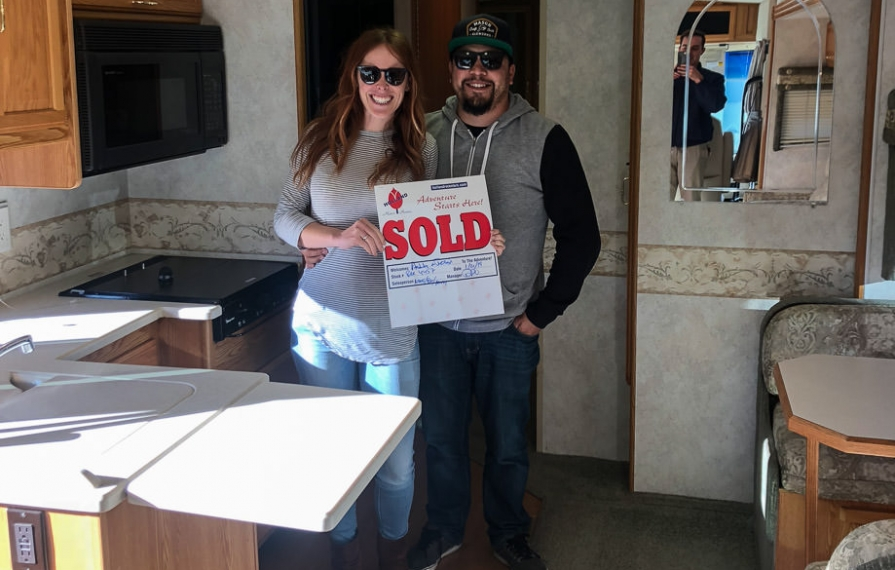 Ashley and Jessie holding sold sign in Brave