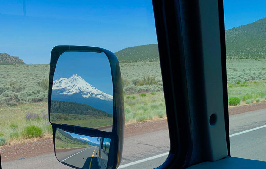 View of Mount Shasta from driver's side mirror of Vista