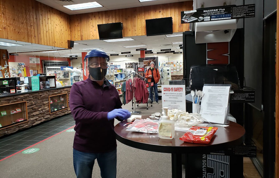 Check in station inside Factory Service Center with Covid safety rules, sanitizer, and masks