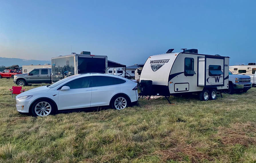Tesla and Micro Minnie parked on grass
