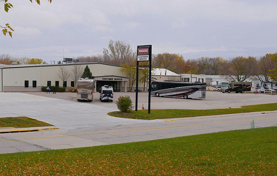 Motorhomes parked in the Winnebago Factory Service Center parking lot