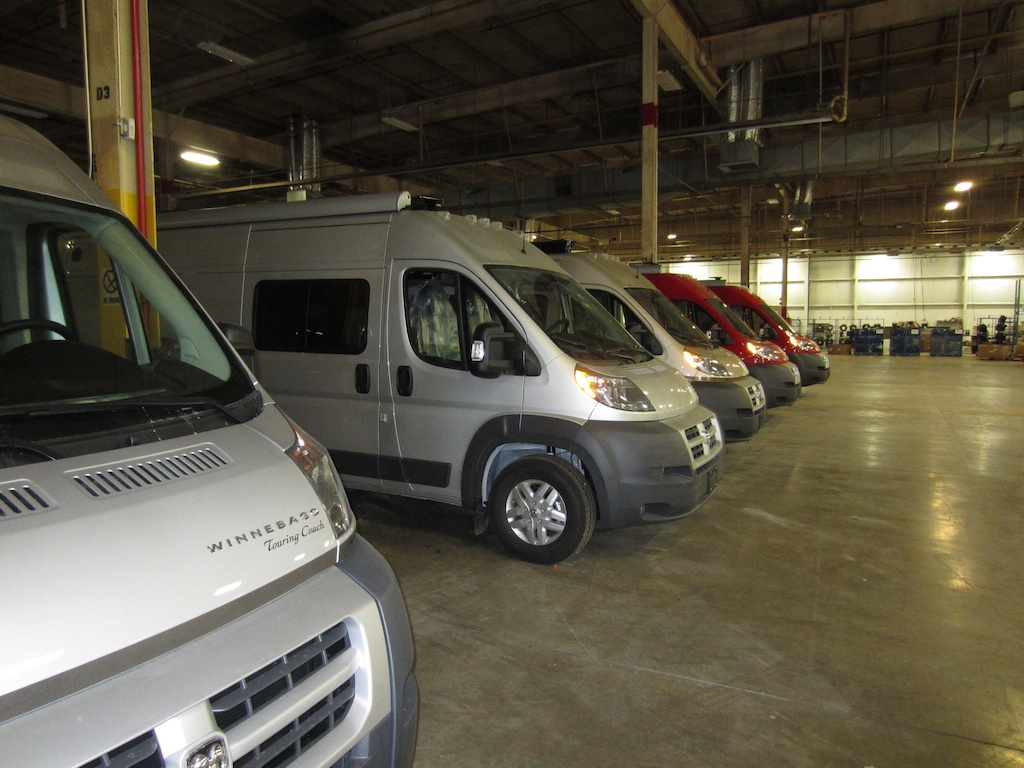 Line of finished Winnebago Travatos inside factory.
