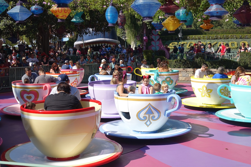 People on the tea cup ride at Disneyland.