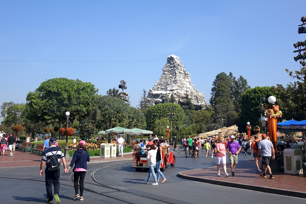 Crowds walking along the streets of Disneyland.