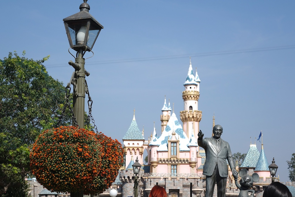 Statue of Walt Disney and the Castle at Disneyland.