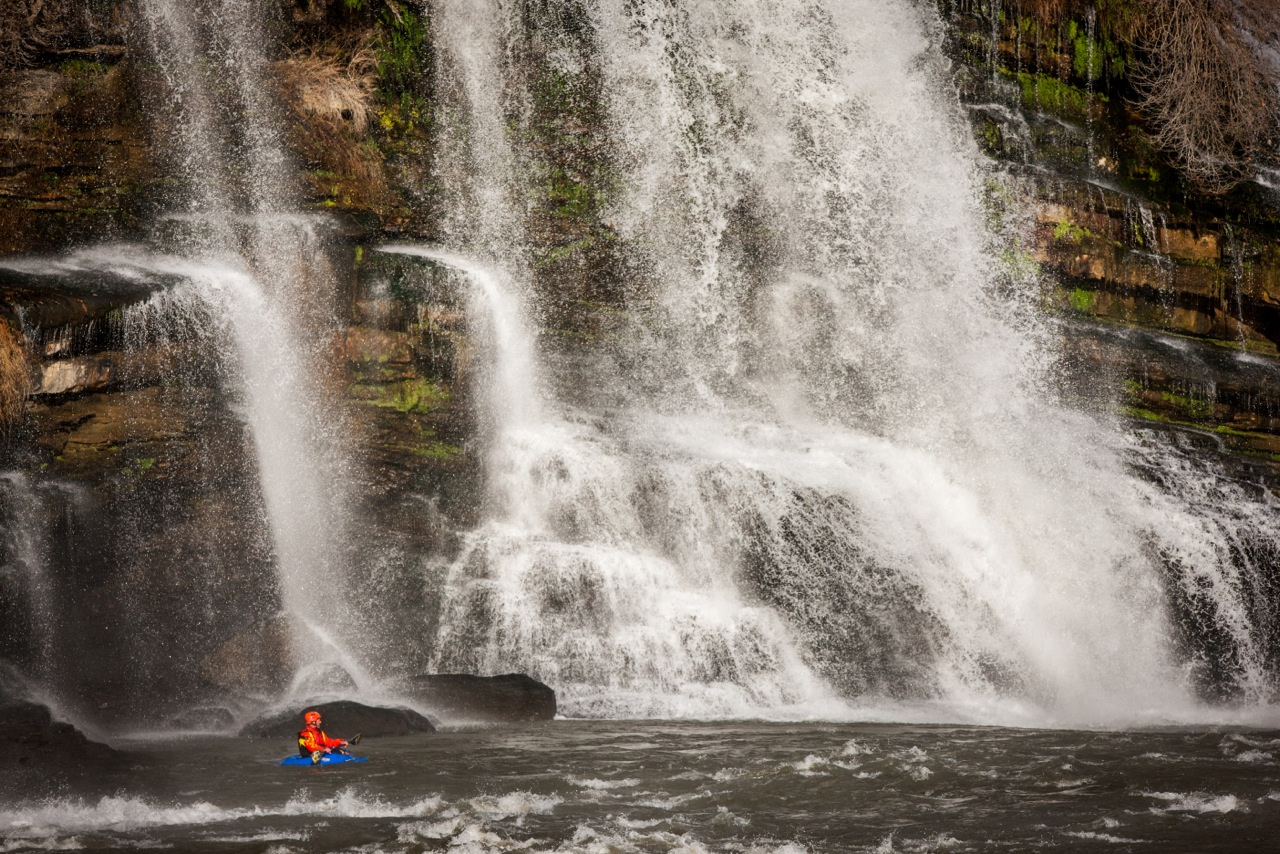 Kayaker in the water below Rock Island Falls.