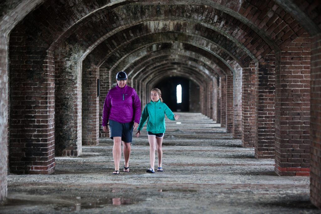 Kathy and Abby walking through brick archway at Fort Jefferson.