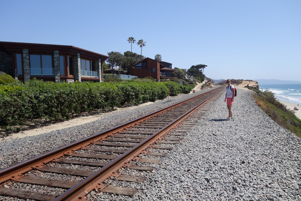 Terry standing next to Amtrak route with ocean in background