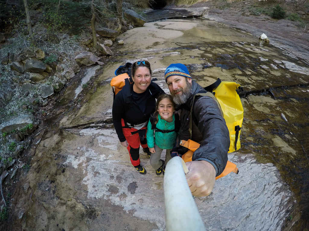 Holcombe family taking a selfie on the canyon floor.