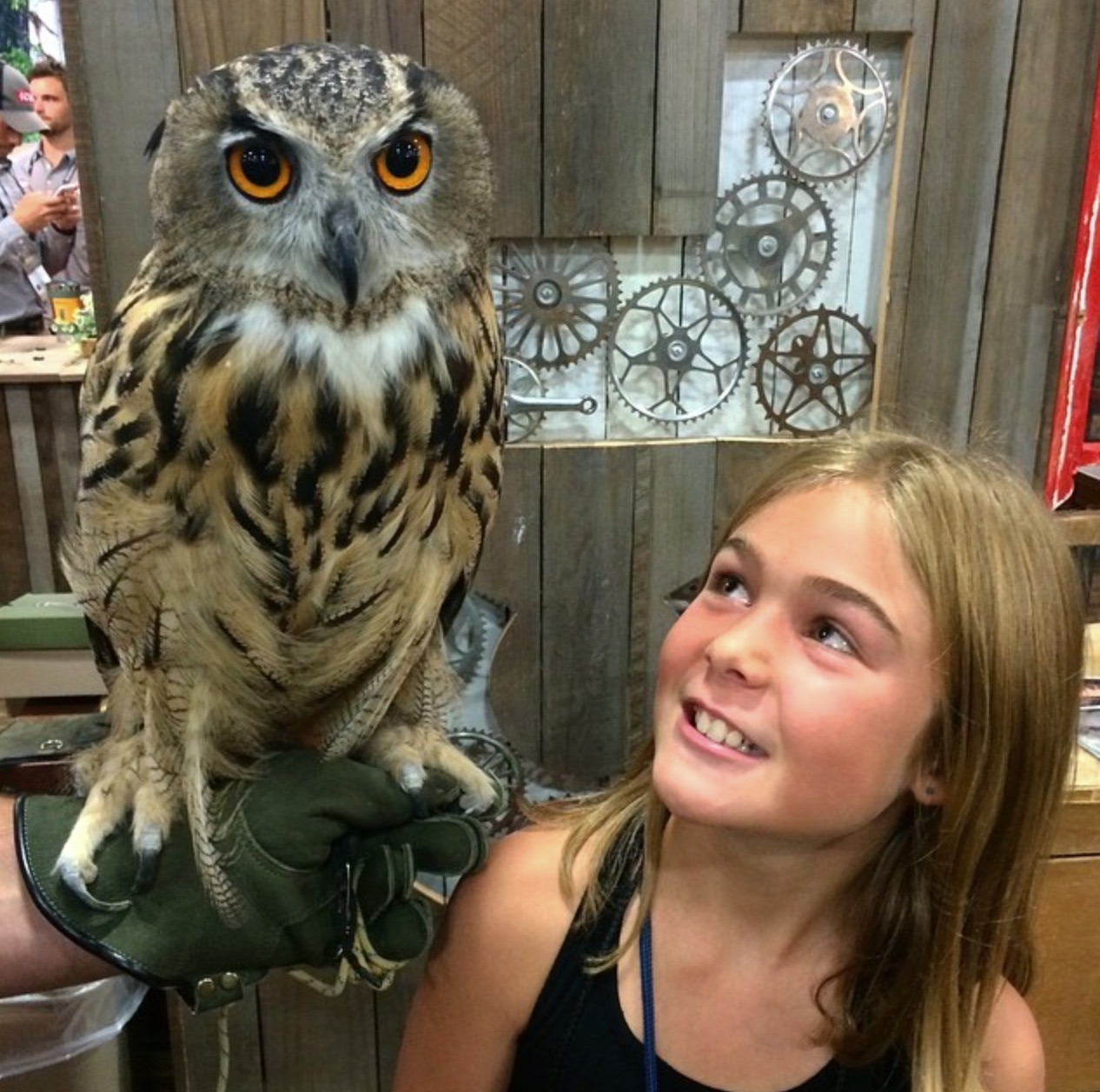 Abby standing next to an owl