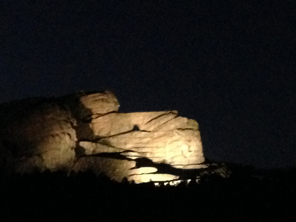 Crazy Horse monument lit up at night.