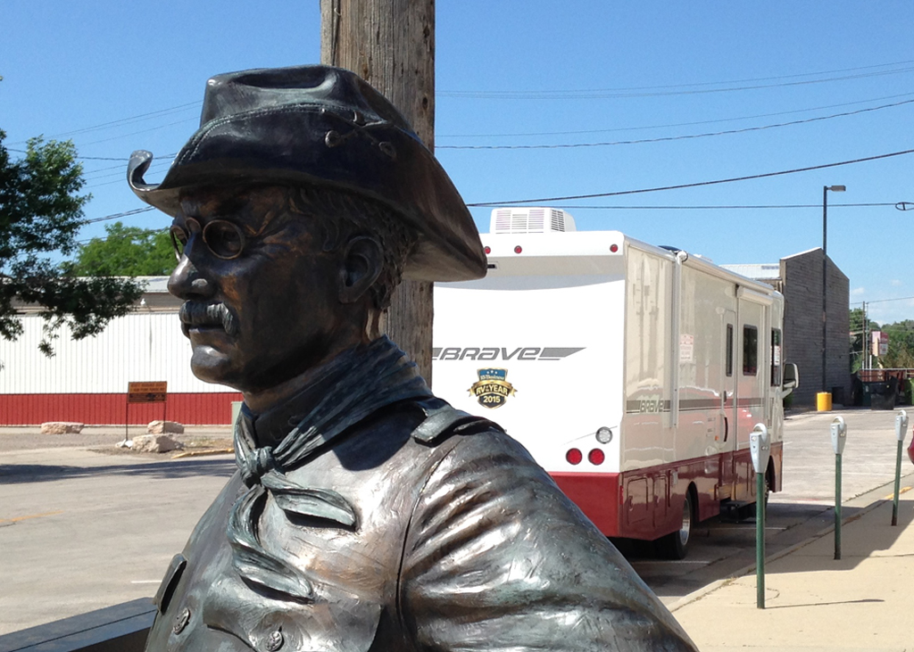 Statue of Theodore Roosevelt with Winnebago Brave in the background.