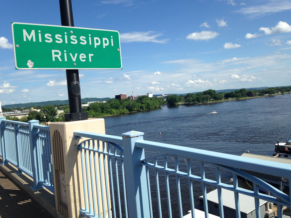 Sign for the Mississippi on bridge above the river.
