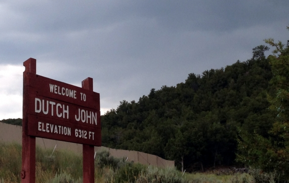 "Sign that reads ""Welcome to Dutch John Elevation 6312 FT."""