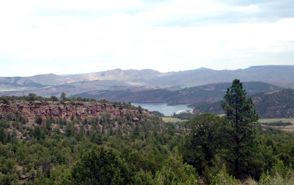 Flaming Gorge with rocky hillsides and mountains as landscape.