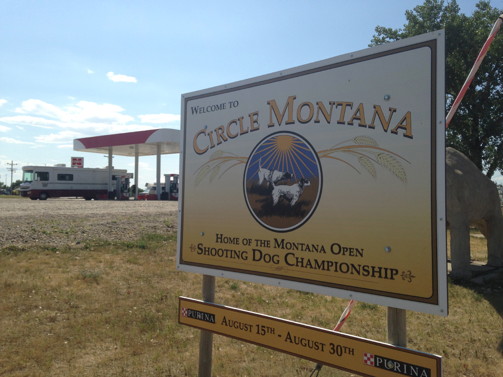 "Sign that reads, ""Welcome to Circle Montana - Home of the Montana Open Shooting Dog Championship."""