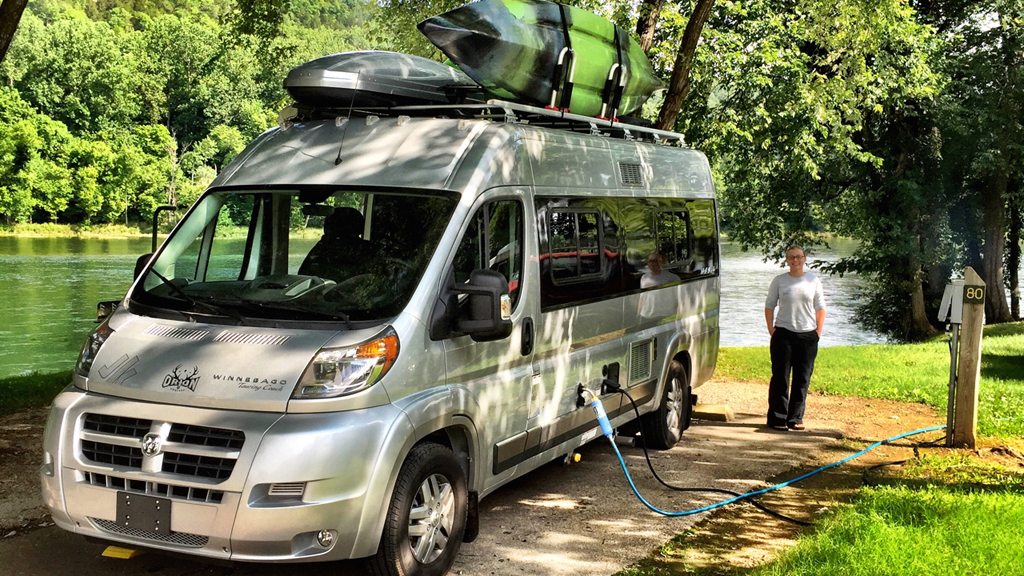 Travato plugged in at campsite at Bull Shoals State Park