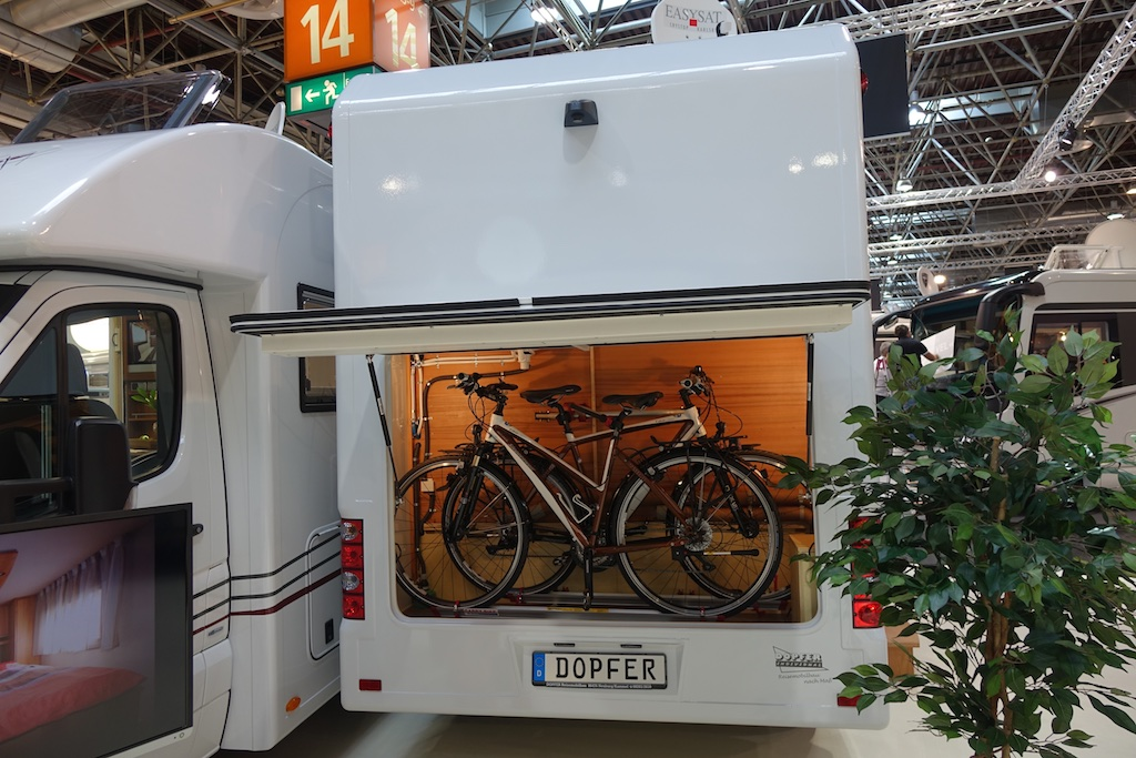 Bikes stored in rear compartment of RV.