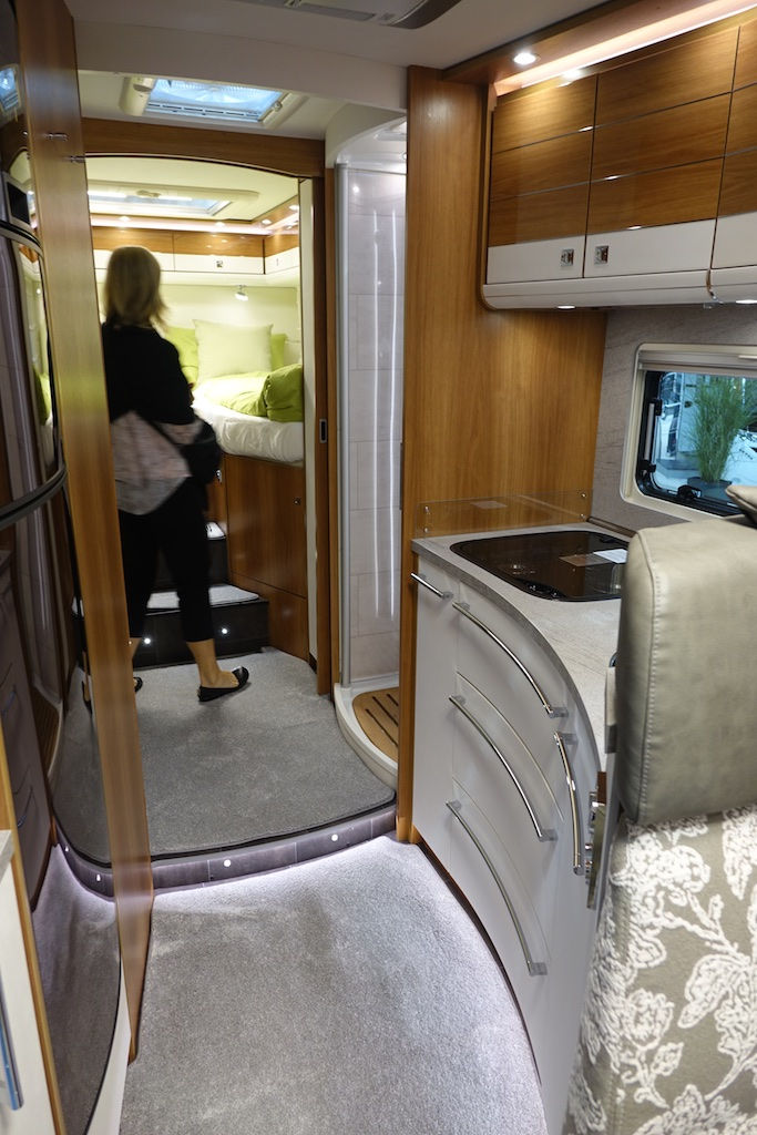 Curved cabinetry and LED lighting in elegant RV.