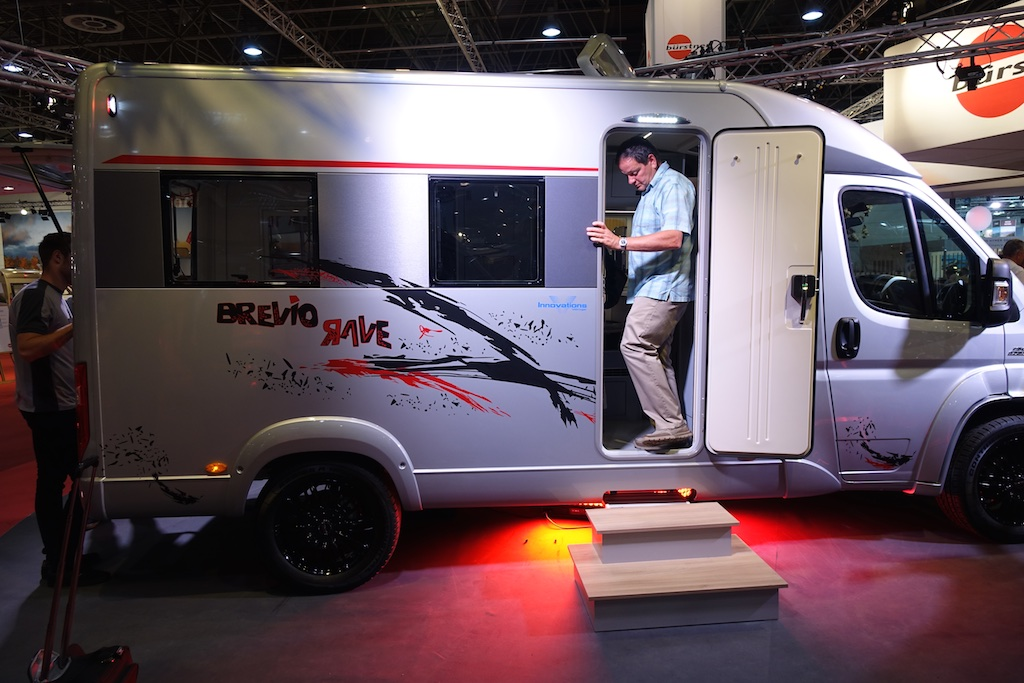 Russ Garfin in one of the ruggedized sport coaches on display at the show.