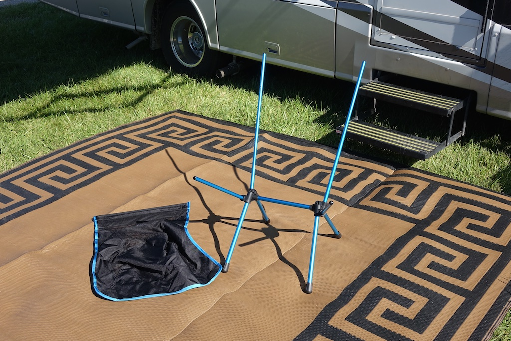 Helinox chair frame and cover on mat outside motorhome.
