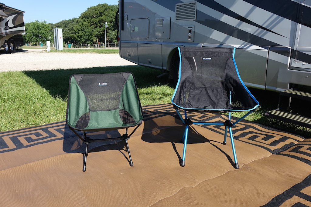 Two Helinox camping chairs set up outside a motorhome.