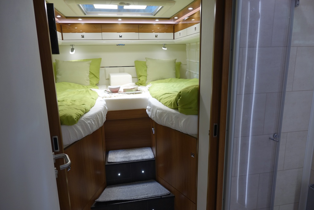 Raised rear beds in an RV.