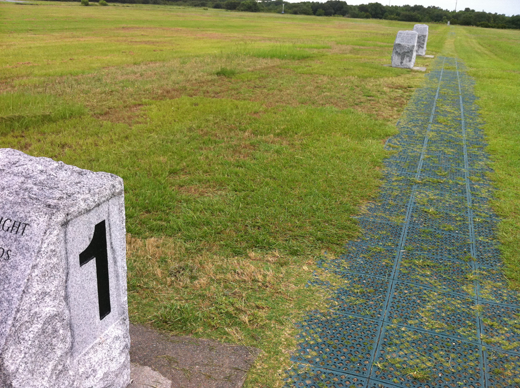 Granite markers in a field.