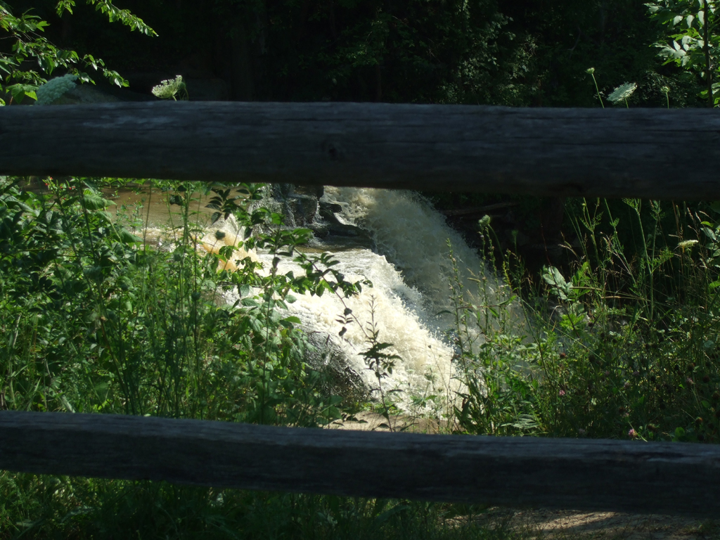 Wooden fence with Brandywine Falls behind it.